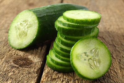 cucumber-slice-wooden-bkg-opt