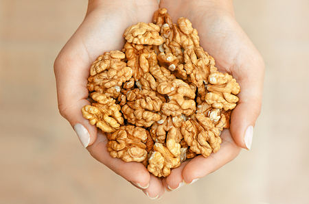 walnuts in hands