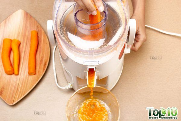 put the carrots through the juicer
