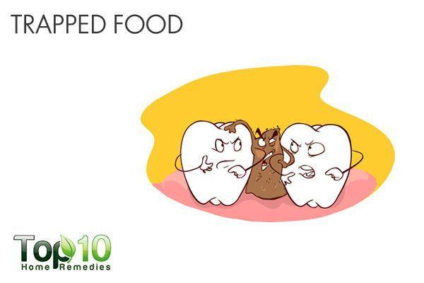 food trapped between teeth causes bad breath
