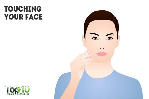 touching your face frequently causes clogged pores