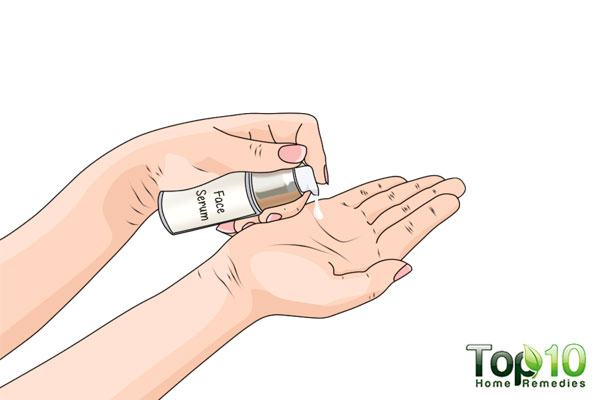Squeeze out a dime-sized portion of face serum into your palm for the face massage