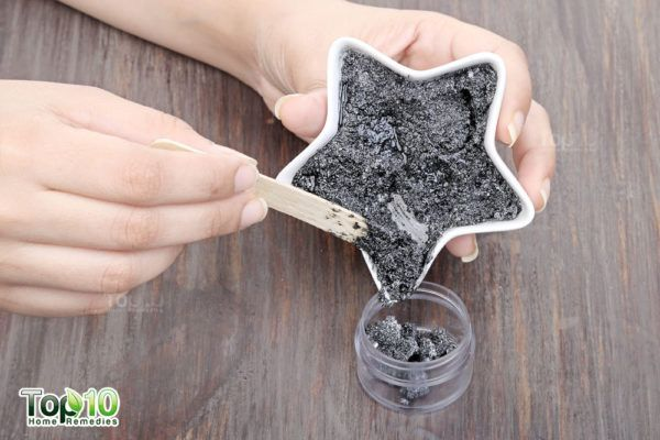 transfer activated charcoal toothpaste in airtight container